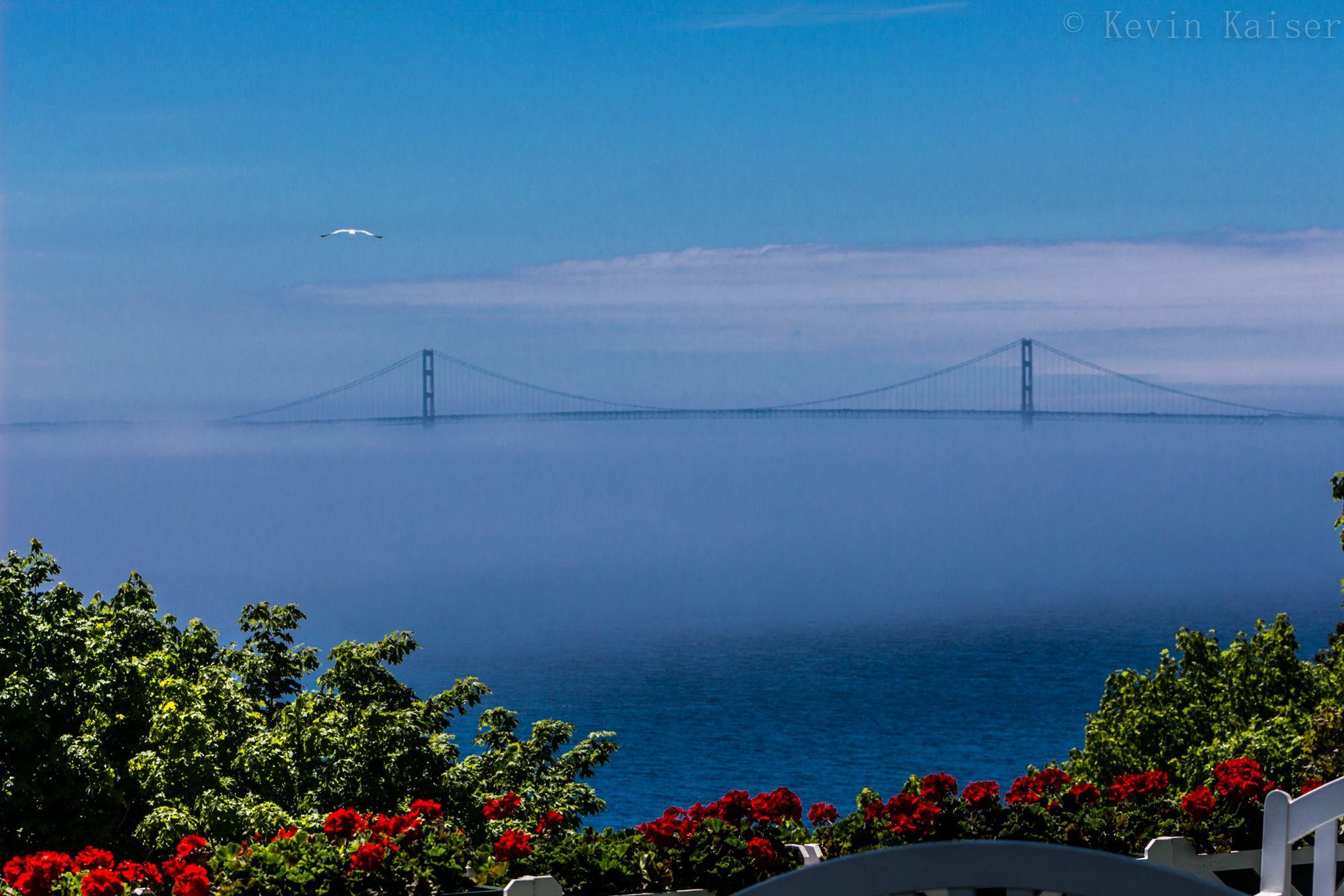 The Mackinac Bridge emerges from the fog of Lake Ontario. (Kevin Kaiser | Travel Beat Magazine)