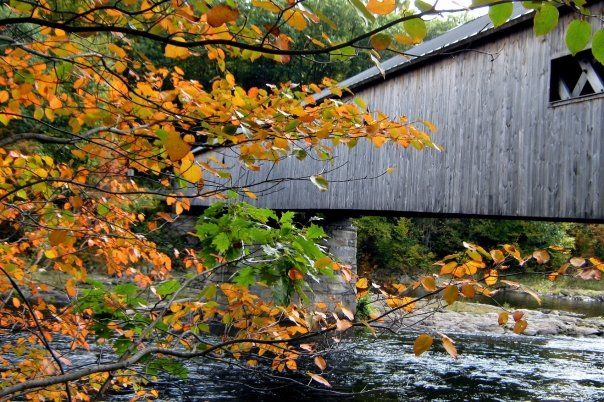 Fall's brilliant golds, greens, reds and oranges makes Vermont's covered bridges shine. (Cheryl Welch | Travel Beat Magazine)