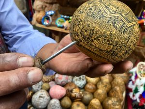 Gourds such as these are carved in precise detail to tell the story of the Inca. (Kevin Kaiser | Travel Beat Magazine)