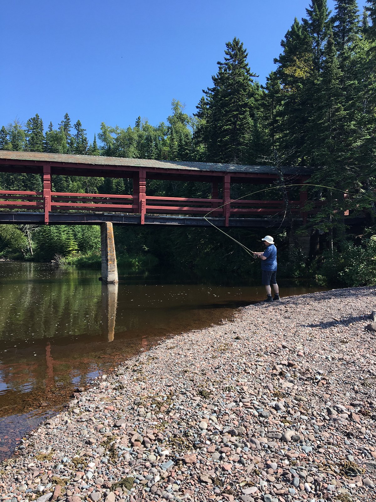 Try your hand at a variety of activities - such as fly fishing, paddle boarding, and sea kayaking at the historic Lutsen Resort. (Cheryl Welch | Travel Beat Magazine)
