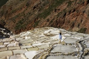 As the pools of salinated water evaporate, the salt crystals form and are harvested. (Kevin Kaiser | Travel Beat Magazine)